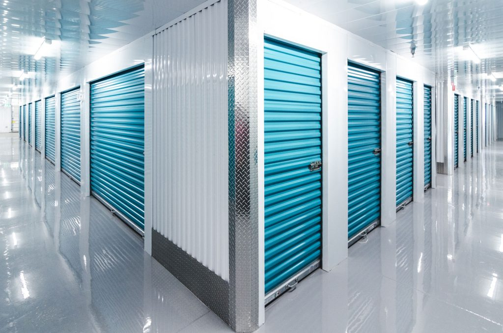 Two brightly-lit hallways, filled with rows of storage lockers at UltraStor.