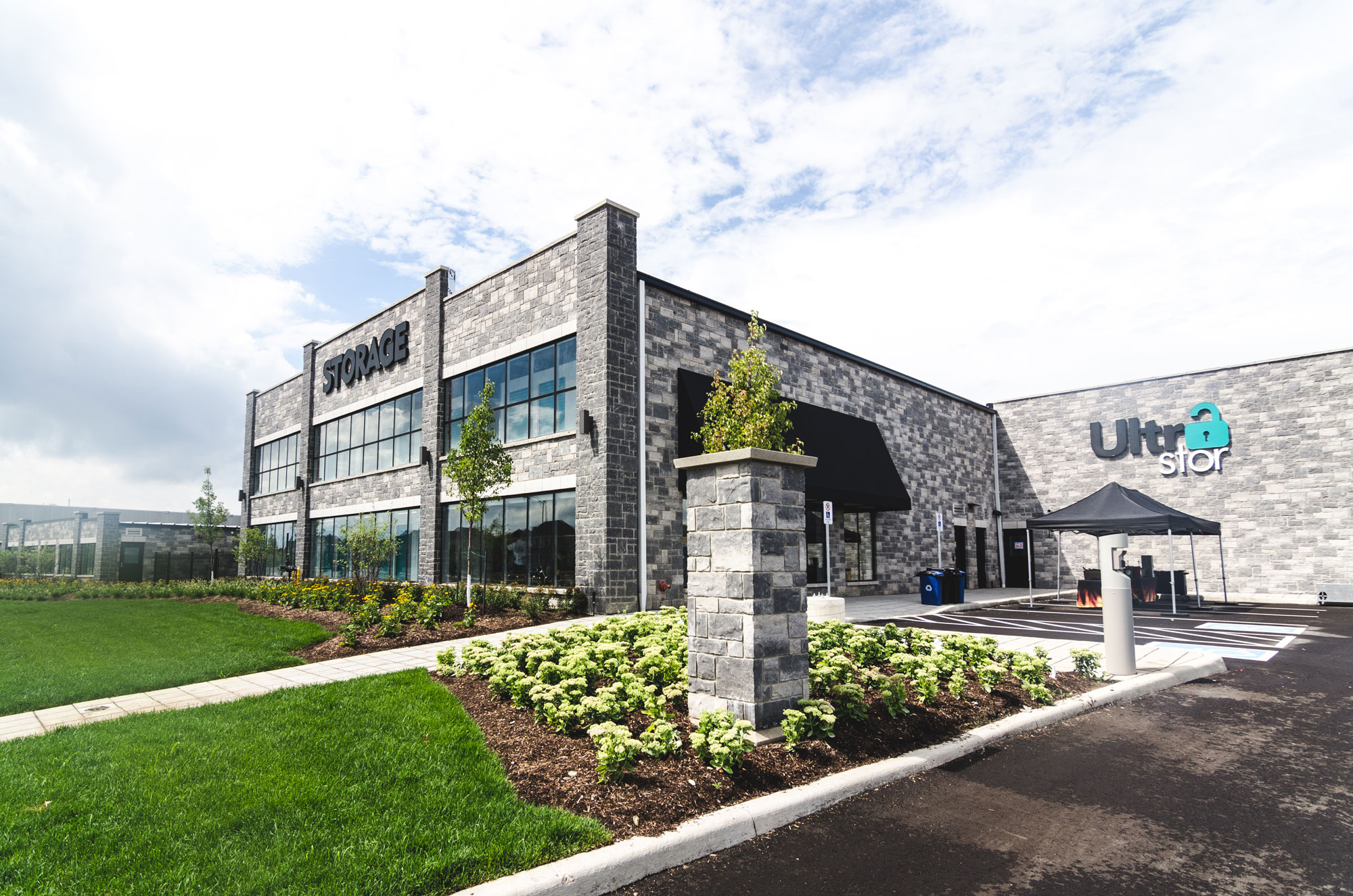 Front of the UltraStor Burlington location, with gardens and the driveway.