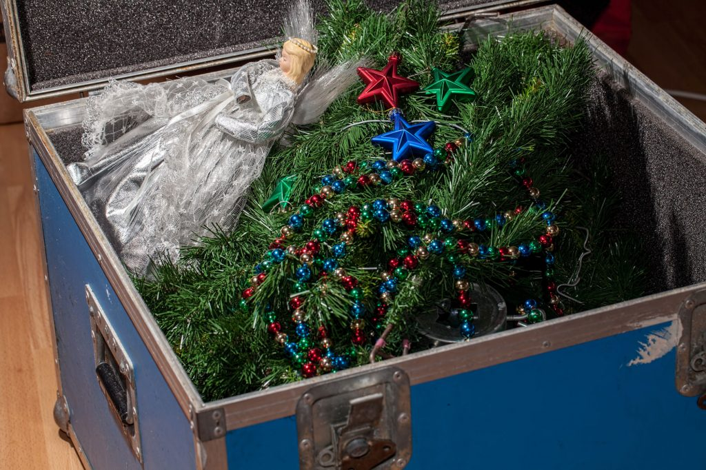Box filled with Christmas decorations, getting packed away to UltraStor storage.
