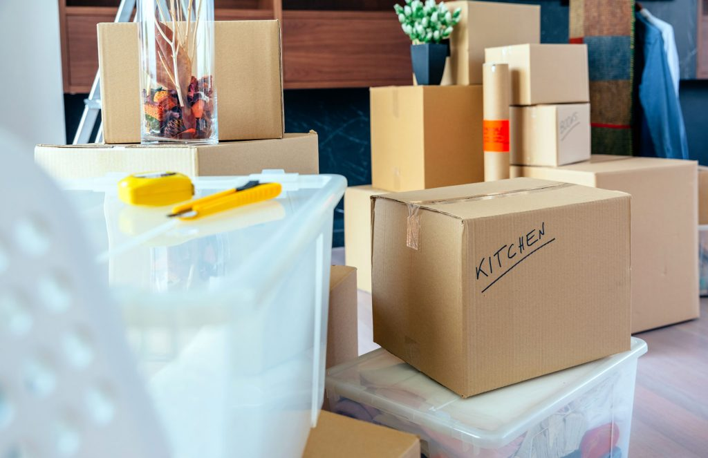 Labelled boxes, clear totes and various moving materials for storage at UltraStor.