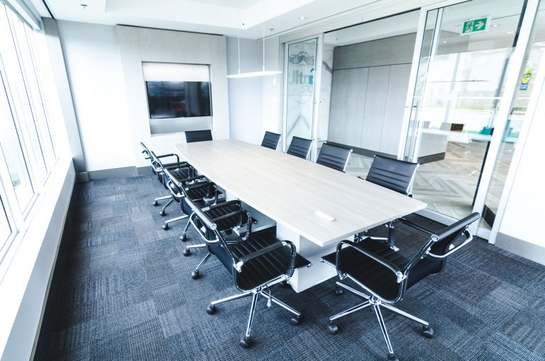 UltraStor Burlington boardroom with television and space for up to 12 people.
