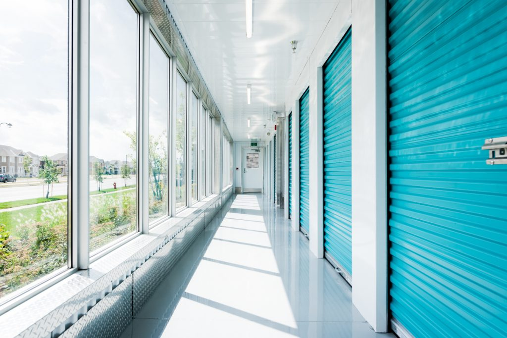 Hallway of UltraStor units on one side and windows facing the outdoors on the other side.