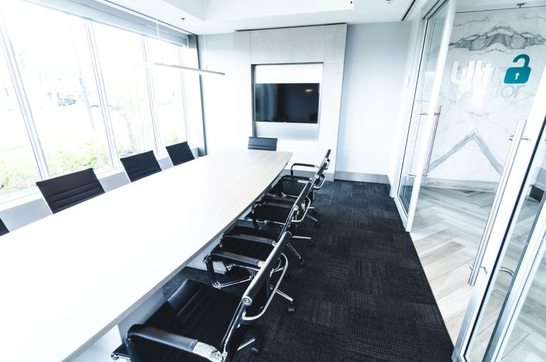 UltraStor Burlington boardroom with television and space for up to 12 people. Looking outside.
