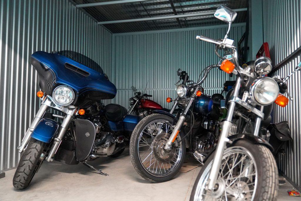 Five different motorcycles stored together in an indoor storage locker at UltraStor.